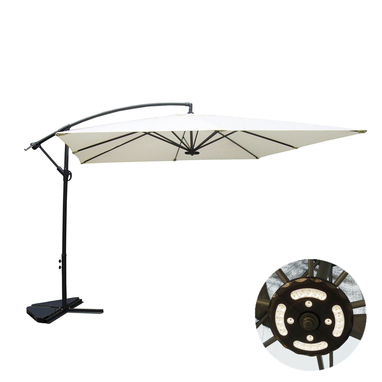 Solenzara à LED écru : Parasol à LED déporté 3x3m.  Solenzara à LED écru : Pasaol à LED déporté 3x3m  Ultra maniable, le parasol Solenzara à LED est équipé dune manivelle anti-retour et dune poignée d'inclinaison. Une fois ouvert, il est inclinable et rabattable à la verticale, de quoi profiter du soleil en toute sécurité. . Déporté, son pied vous permet de l'installer aussi bien au-dessus dune grande table qu'autour de bains de soleil, pour vous protéger du soleil en toute sérénité. Equipé dune lampe à LED, il est parfait pour prolonger vos soirées en extérieur. . Doté d'un auvent sur le sommet, il permet à l'air de circuler et d'éviter les chutes possibles dues aux bourrasques. . Sa structure est composée d'un premier tube externe en aluminium afin de garantir une meilleure protection contre l'oxydation ainsi que d'un second tube interne en acier pour apporter plus de solidité. . La densité de la toile est de 180g/m² et son pied en croix peut être lesté à laide de dalles. . . CARACTERISTIQUES TECHNIQUES . .  Couleur de la toile : écru . Couleur de la structure : gris anthracite . . DIMENSIONS. . Toile : 180g/ m² . Pied : croix permettant de fixer le parasol au sol (dalles à lester non incluses) . . Armature recouverte de peinture epoxy afin de garantir une meilleure protection contre l'oxydation . . CONDITIONNEMENT. . Livré en 1 colis de 11.5 kg : 195 x 32.5 x 14 cm . . * Livraison pas de porte . * Garantie 2 ans