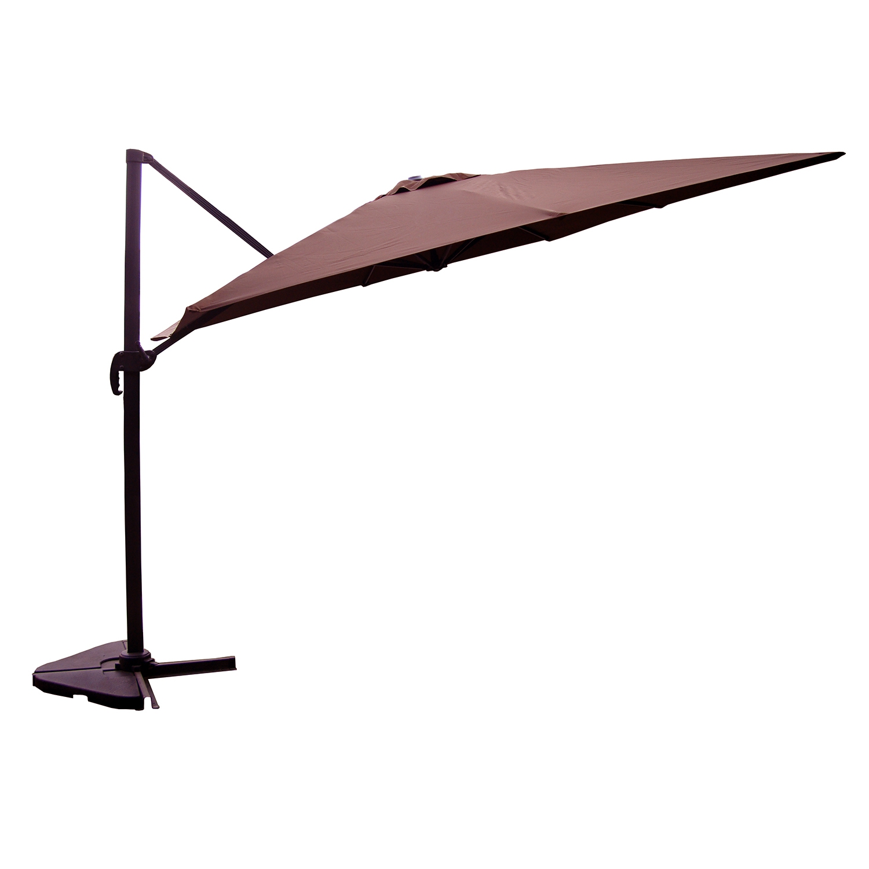 Palatino chocolat : Parasol déporté, carré de 3x3m, rotatif à 360°.  Palatino chocolat : Parasol déporté, carré de 3x3m, rotatif à 360° Ce parasol déporté, de forme carrée (3x3m), est l'accessoire indispensable de votre jardin ou votre terrasse, pour se protéger efficacement du soleil ou des petites averses. . Il se manipule facilement grâce à sa manivelle anti-retour, sa poignée d'inclinaison et sa pédale de rotation. . De plus, ce parasol de jardin est inclinable et rabattable à la verticale une fois ouvert. De plus, il possède un auvent sur le sommet, ce qui permet à l'air de circuler, et, en cas de légère brise, de ne pas prendre le vent. . Sa structure est entièrement fabriquée en aluminium et recouverte de peinture anthracite, du mat à la poignée, jusqu'aux baleines, ce qui lui confère une durée de vie et une résistance maximales aux conditions extérieures. . La toile en polyester dune densité de 230g / m², garantit une opacité importante et un ombrage efficace, filtrant les rayons du soleil. Le tissu est enduit d'un produit hydrofuge, rendant la toile déperlante au contact de l'eau. . Ce parasol est vendu avec la structure, la toile et le pied. Seules les dalles seront à prévoir pour le figer au sol. . Son pied en forme de croix peut être fixé dans un sol dur. . . CARACTERISTIQUES TECHNIQUES . .  Structure : L'armature, les 8 baleines et la poignée sont en aluminium . Couleur de la structure : Gris anthracite . Taille : 3x3x2.6m . Coloris toile : Chocolat (Marron) . Rotatif : Oui à 360° . Forme : Carré . . DIMENSIONS. . Dimensions du mât : 53x77mm (Alu : 2mm d'épaisseur) . Hauteur du parasol : 2,60m . Grammage toile : 230 gr/m² . . Montage : L'ensemble est livré en kit à monter soi-même. Le montage est très facile : une notice est fournie. . . CONDITIONNEMENT. . Nombre de cartons :.  1 Dimensions du colis : 269x38,5x14cm . . Le mât est en aluminium pour une plus grande protection contre l'oxydation, et pour plus de solidité, il est renforcé par un tube en aci